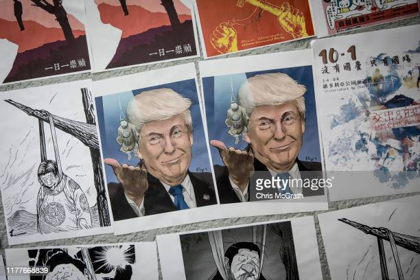 A poster showing US President Donald Trump is seen on a prodemocracy Lennon Wall ahead of a rally to mark the fifth anniversary of the 2014 Umbrella...