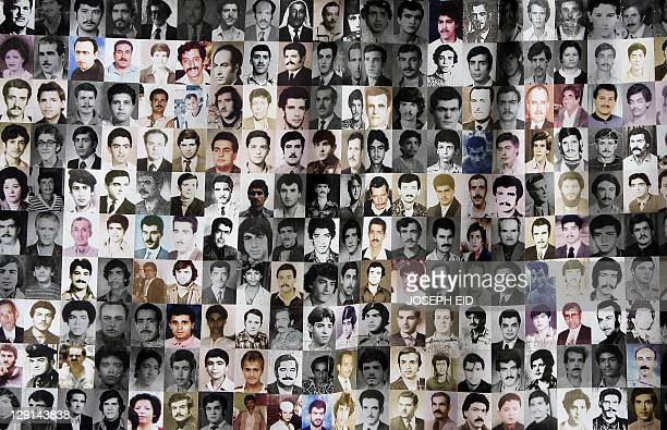 A poster shows portraits of missing Lebanese people hangs in front of a tent erected by their relatives at the entrance of the United Nations...