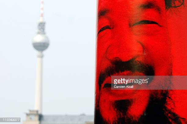 A poster shows the conterfei of Ai Wei Wei as activists place in front of the Chinese embassy in a symbolic protest against the arrest of dissident...