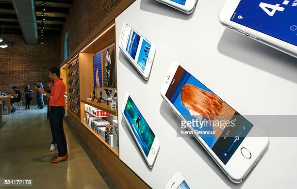 A poster that contains pictures of iPhones is displayed the new Brooklyn Apple Store during a media preview in the Williamsburg neighborhood of...