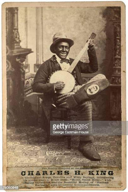 Poster to promote a performance by 'Master Banjoist of the Universe' and blackface minstrel performer Charles H King 1880s He holds a banjo and sits...