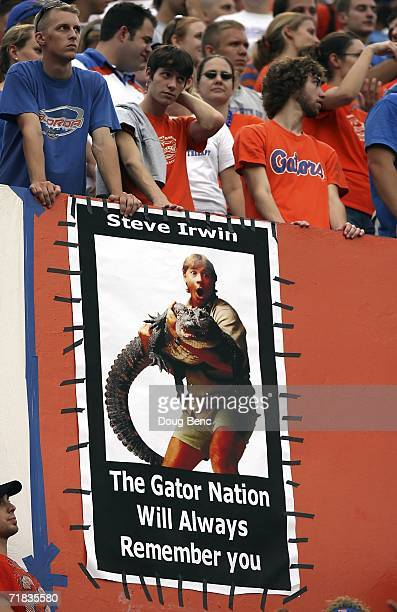 A poster tribute to Steve Irwin 'The Crocodile Hunter' hangs in the corner of the stadium as the University of Central Florida Golden Knights takes...