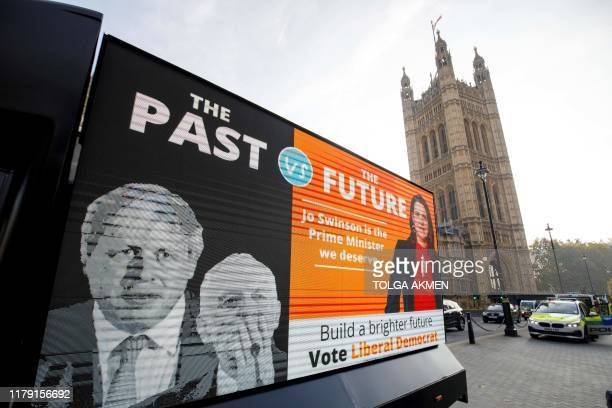 A poster van shows the Liberal Democrat slogan for the upcoming general election in central London on October 3 2019 Britain will go to the polls on...