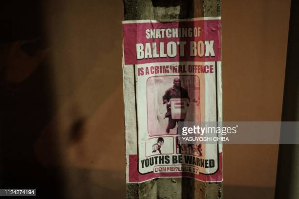 A poster with a message reading snatching ballot box is a criminal offence is seen in Lagos Nigeria on February 12 2019 Nigerians will cast their...