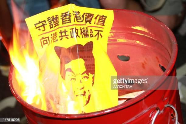 A poster with a picture of Hong Kong chief executive Leung Chunying reading Guard the values of Hong Kong tell Hong Kong people to say no to...