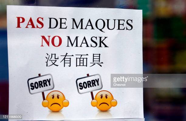 """Poster with indication """"No mask"""" is displayed on the windows of a pharmacy as people rushed to buy disinfectant hand gel to fight the outbreak of..."""