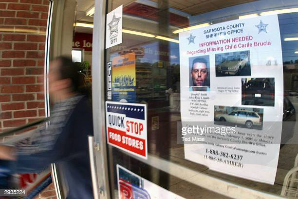 A poster with information on Carlie BruciaÕs abduction is seen taped to the door of a local convenience store February 5 2004 in Sarasota Florida...