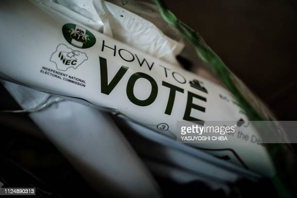 A poster with instructions on how to vote is seen in a kit before delivering to polling stations ahead of Nigeria's Presidential election at an...