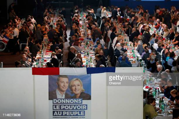 A poster with photos of the lead candidate for Marine Le Pen's rightwing populist National Rally Jordan Bardella and President of the French farright...