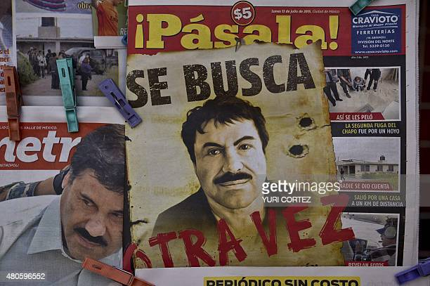 A poster with the face of Mexican drug lord Joaquin El Chapo Guzman reading Wanted Again is displayed at a newsstand in one Mexico City's major bus...