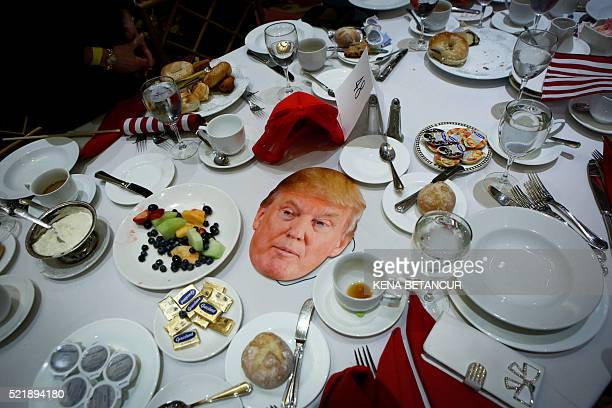 A poster with the face of Republican presidential candidate Donald Trump is seen on a table at the Republican Party's annual Lincoln Day Brunch in...