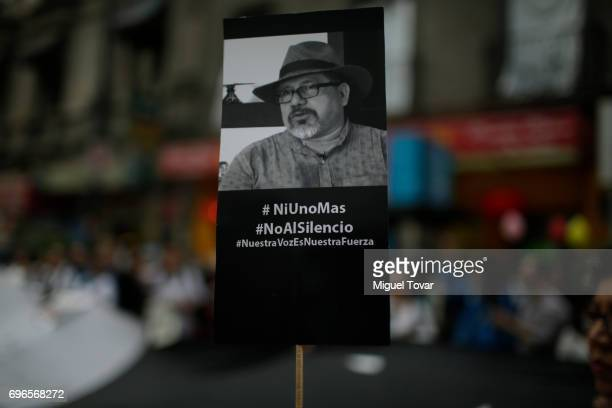 A poster with the image of the murdered journalist Javier Valdez is seen during a demonstration to end violence against journalists in Mexico outside...
