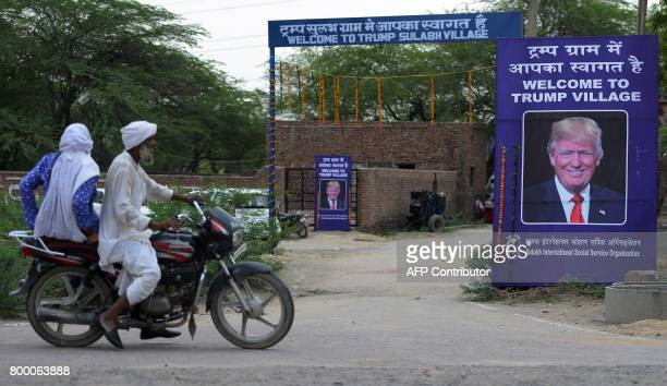A poster with the image of US President Donald Trump is set up at Marora village which has been unofficially renamed 'Trump Village' about 100km from...