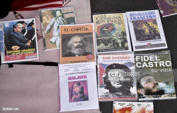 Poster with the photograph of the legendary Argentineborn guerrilla leader Ernesto Che Guevara displayed for sale along with other posters depicting...