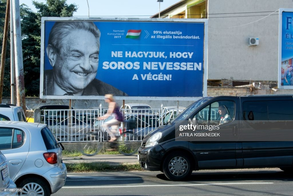 A poster with US billionaire George Soros is pictured on July 6, 2017 in Szekesfehervar, Hungary. The head of Hungary's largest Jewish organisation says a 'poisonous' poster campaign by the government that targets US billionaire George Soros is stoking anti-Semitic sentiments and urged its immediate scrapping. STORY