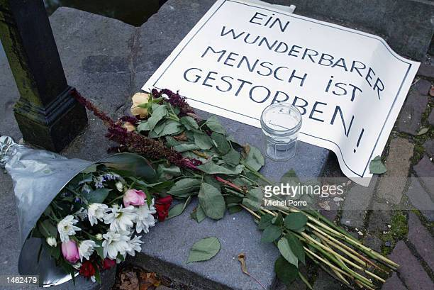 A poster written in German 'A wonderful man has died' lies outside the royal Huis ten Bosch Palace after Prince Claus of the Netherlands husband to...