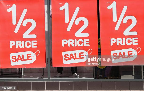 Posters advertising a sale are displayed in a shop window of a shop in the high street on September 29 2015 in Redcar England Following the...