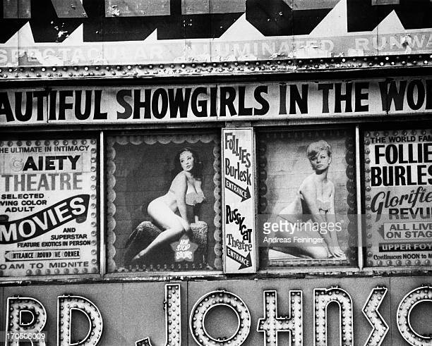 Posters advertising burlesque shows at the Follies Burlesk and Gaiety Theater in in Times Square New York City 1975