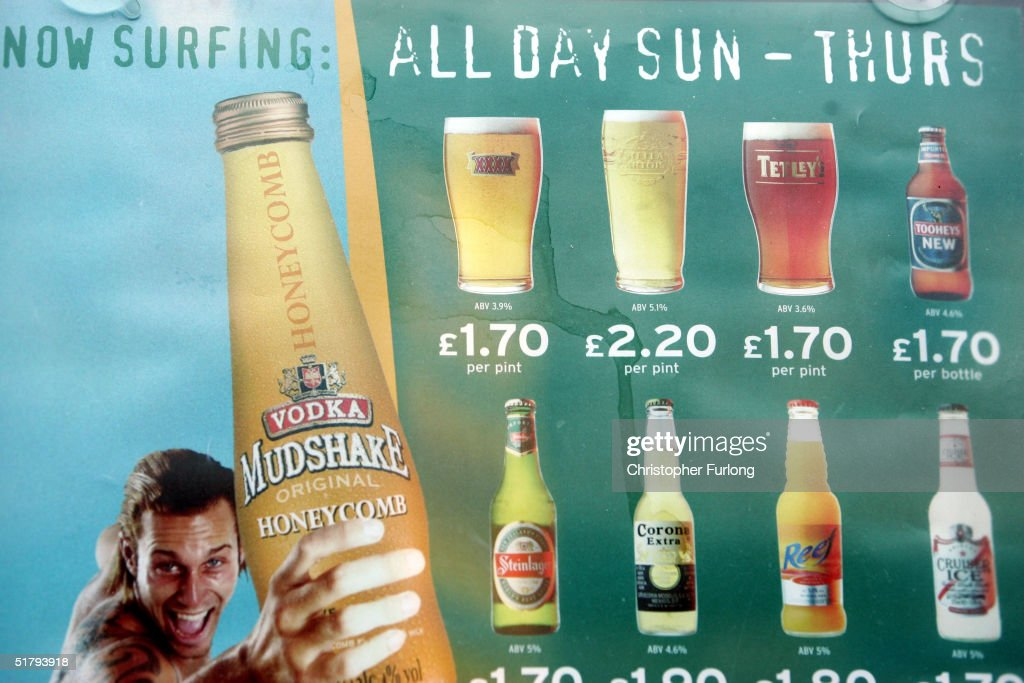 Posters advertising cheap alcoholic drinks displayed on November 26, 2004 in Glasgow, Scotland. The Scottish Executive has announced a major campaign designed to call time on the binge drinking culture which creates bad health and anti social behaviour. It is estimated that drink related problems cost the people of Scotland over GBP1bn a year. Glasgow City Council has already banned 'happy hours' where cut price drinks can be bought at specific times.