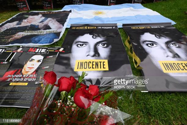 Posters and flowers placed by fans gathered outside Michael Jackson's final resting place at the Holly Terrace mausoleum in Forest Lawn Cemetery in...
