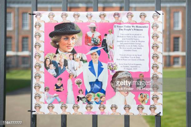 Posters and pictures of Princess Diana attached to the gates outside Kensington Palace in London, as the anniversary of her death is expected to be...