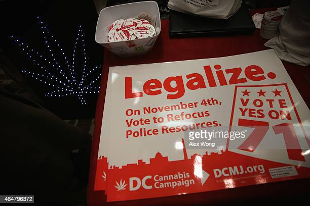 Posters and stickers regarding Washington, DC's marijuana legalization are seen during a ComfyTree Cannabis Academy conference February 28, 2015 in...