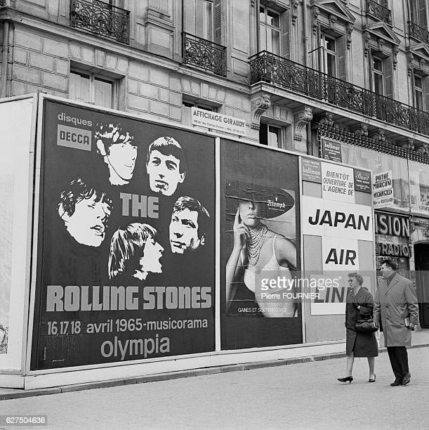 Posters announce the forthcoming tour dates for The Rolling Stones at the Olympia music hall