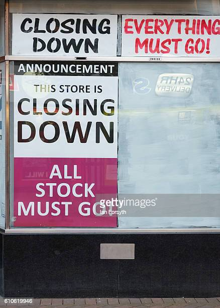 Posters are displayed in a shop window on September 27 2016 in Redcar United Kingdom One year on since the SSI steel making plant at Redcar was...