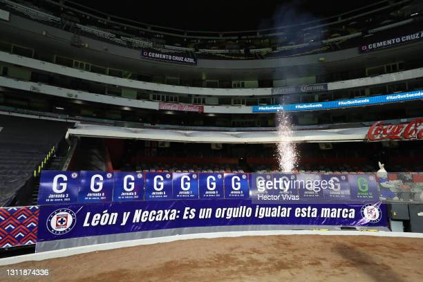 Posters are displayed to show the twelve consecutive victories that Cruz Azul has in this tournament after the 14th round match between Cruz Azul and...