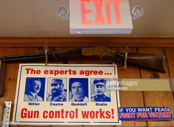 Posters are on display at Clark Brothers gun store in Warrenton Virginia some 48 miles from Washington DC on January 16 2020 When Sheriff Scott...