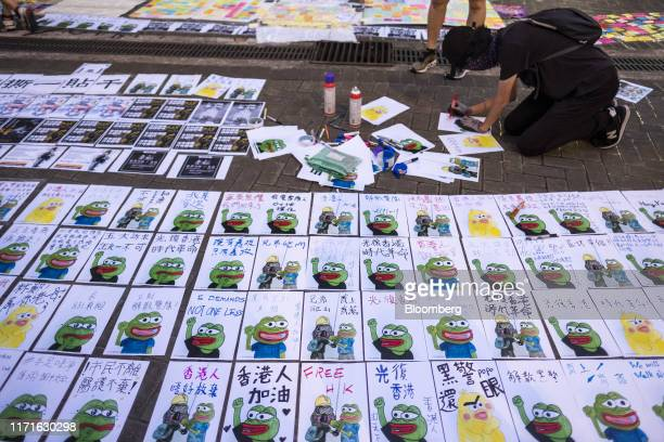 Posters featuring Pepe the Frog are posted on a sidewalk outside the Central Government Offices during a protest in the Admiralty district of Hong...