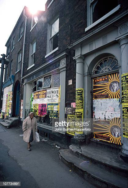 Posters for appearances by Twiggy Eric Clapton and Fleetwood Mac posted on a terrace of Georgian houses in Manchester England in 1976