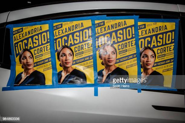 Posters for progressive challenger Alexandria OcasioCortez outside her victory party in the Bronx after OcasioCortez upset incumbent Democratic...