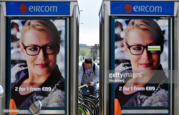 Posters for spectacle manufacturer Specsavers Optical Group Ltd cover the windows of fixedline public telephone booths operated by Eircom Group in...