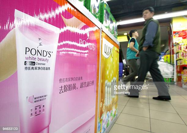 Posters for Unilever's Pond's and Lux brand beauty products are displayed at a supermarket in downtown Beijing China on Tuesday October 10 2006
