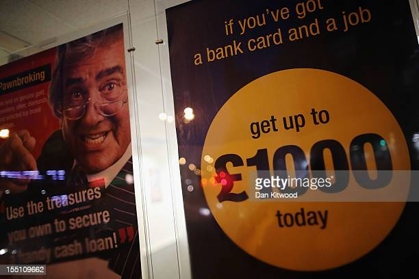 Posters hang in a Pay day loans shop on Brixton High Street on November 1, 2012 in London, England. The recession has changed the face of the UK's...