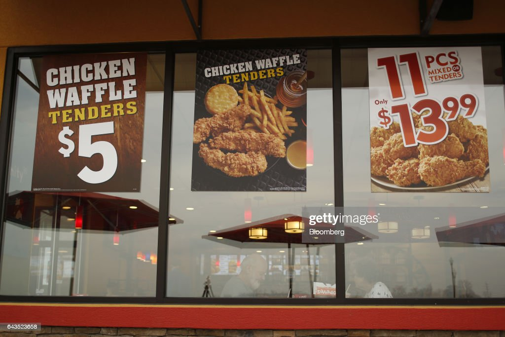 Posters Illustrating Food For Sale Are Displayed Outside A Popeyes