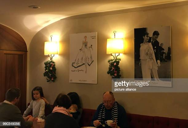 Posters in a café depicting the actress Audrey Hepburn who enjoyed shopping there in Morges Switzerland 07 January 2018 Hepburn died aged 63 in...