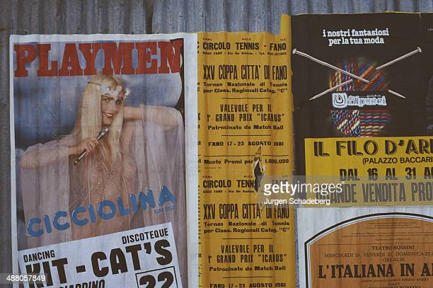 Posters in Italy including one for 'Playmen' magazine featuring Italian porn star and politician Ilona Staller aka Cicciolina 1981