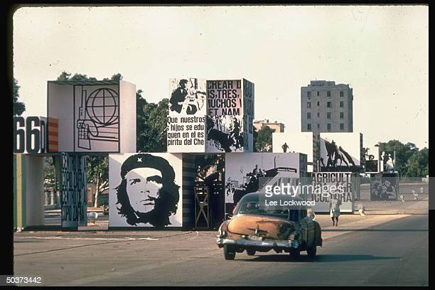 Posters mounted on huge cubes in outdoor street arrangement w large head of Che Guevera represented and references to agriculture and revolution