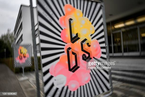 Posters of an exhibition entitled 'LSD the 75 Years of a Problem Child' are seen at the entrance of the Swiss National Library on September 21 2018...
