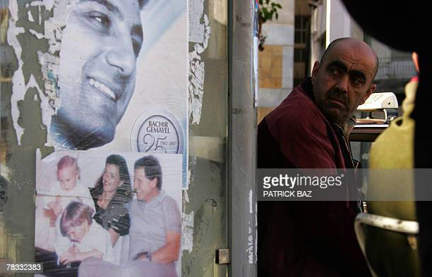 Posters of assassinated Presidentelect Bashir Gemayel and Christian leader Dany Chamoun and his family wife Ingrid and sons Tarek and Julian are...