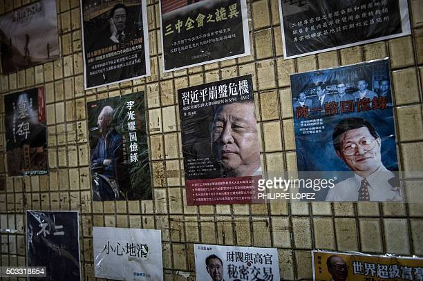 Posters of books about China's politics including some featuring Chinese President Xi Jinping are seen displayed in the staircase leading to a...