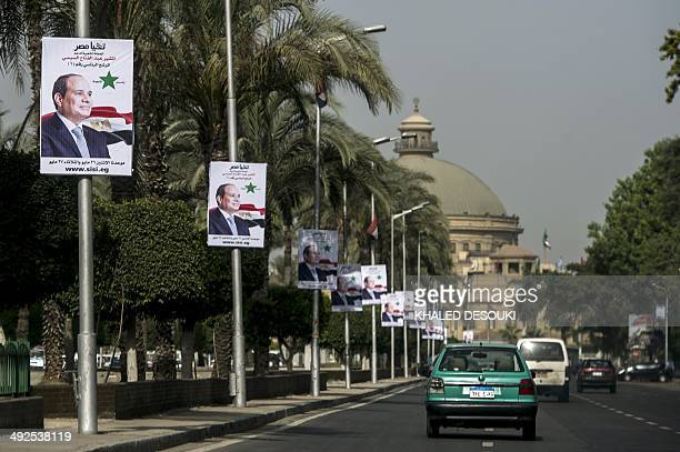 Posters of Egyptian exarmy chief and leading presidential candidate Abdel Fattah alSisi are seen outside Cairo University in the capital on May 21...