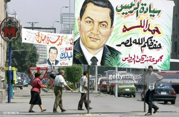 Posters of Egyptian President Hosni Mubarak decorate a street in Cairo 24 September 1999 The Egyptian capital has turned into a blaze of bright...