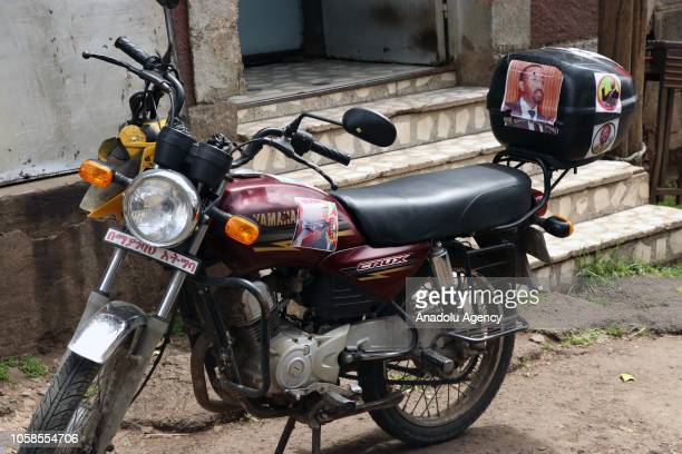 Posters of Ethiopian Prime Minister Abiy Ahmed are seen on a motorbike in Addis Ababa Ethiopia on November 07 2018 Abiy Ahmed who took office this...