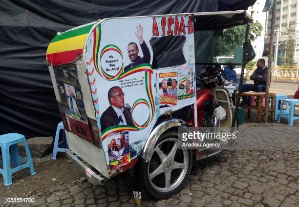 Posters of Ethiopian Prime Minister Abiy Ahmed are seen on a tuctuc in Addis Ababa Ethiopia on November 07 2018 Abiy Ahmed who took office this April...