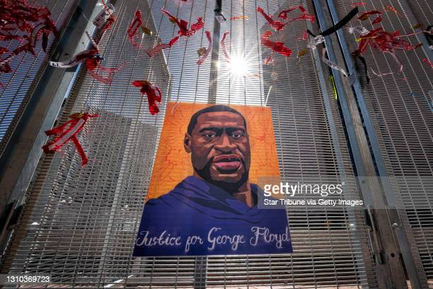 Posters of George Floyd and Philando Castile are zip tied to the security fence around the heavily secured Hennepin County Courthouse during the...