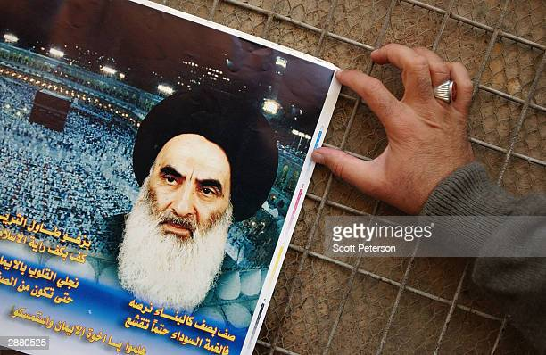 Posters of Grand Ayatollah Ali Sistani, Iraq's pre-eminent Shiite Muslim cleric, are seen January 17, 2004 in the holy Shia city of Karbala, Iraq....