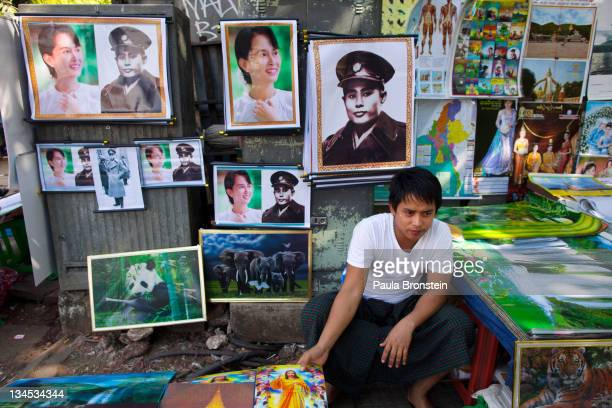 Posters of human rights activist and politician Aung San Suu Kyi and her father Aung San are sold by a street vendor on December 2 2011 in Yangon...